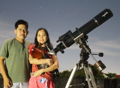 Observing the super moon with our pet rooster